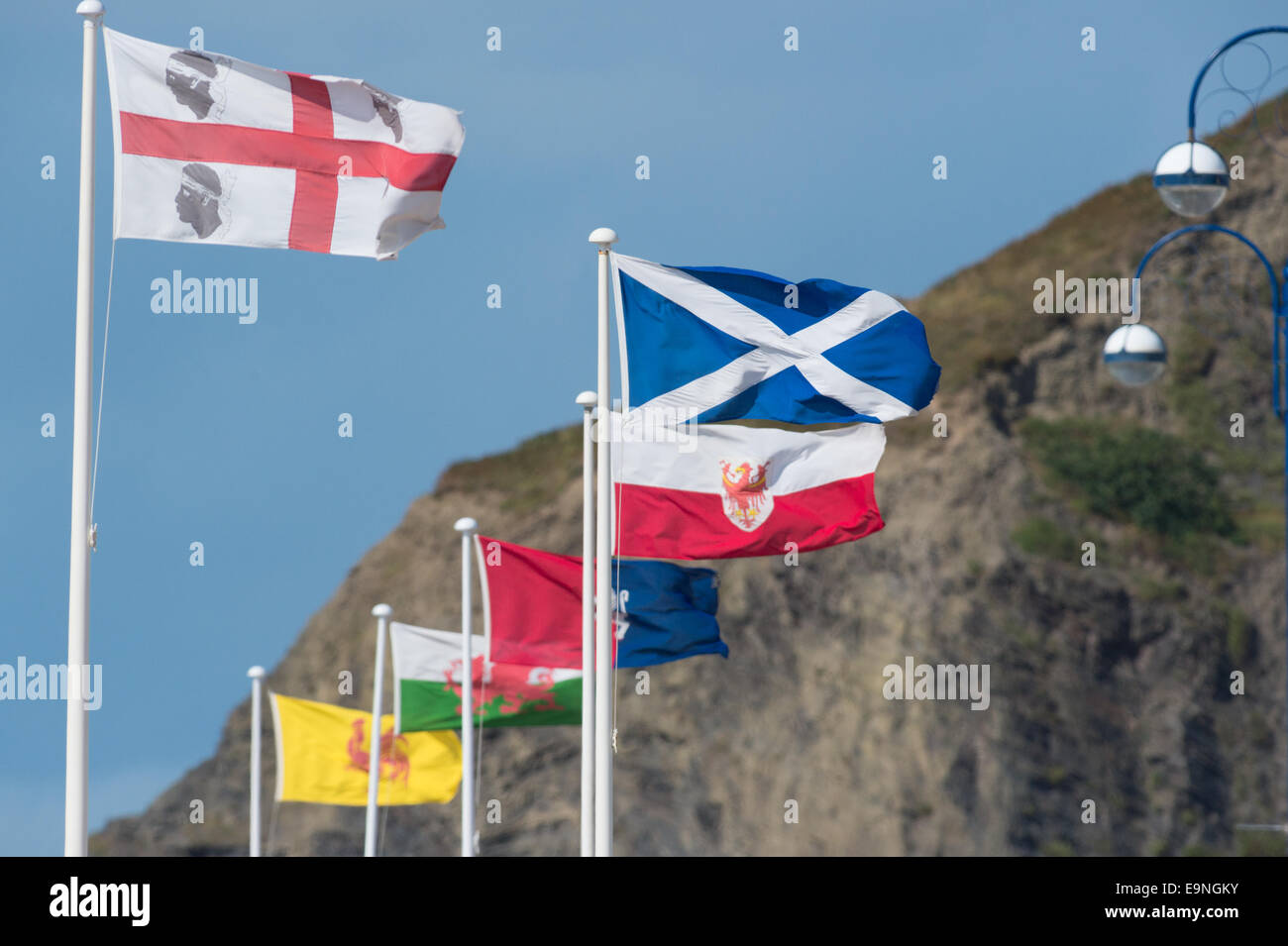 Flags of minority European countries and small nations flying on the promenade at Aberystwyth Wales UK, - Stock Image