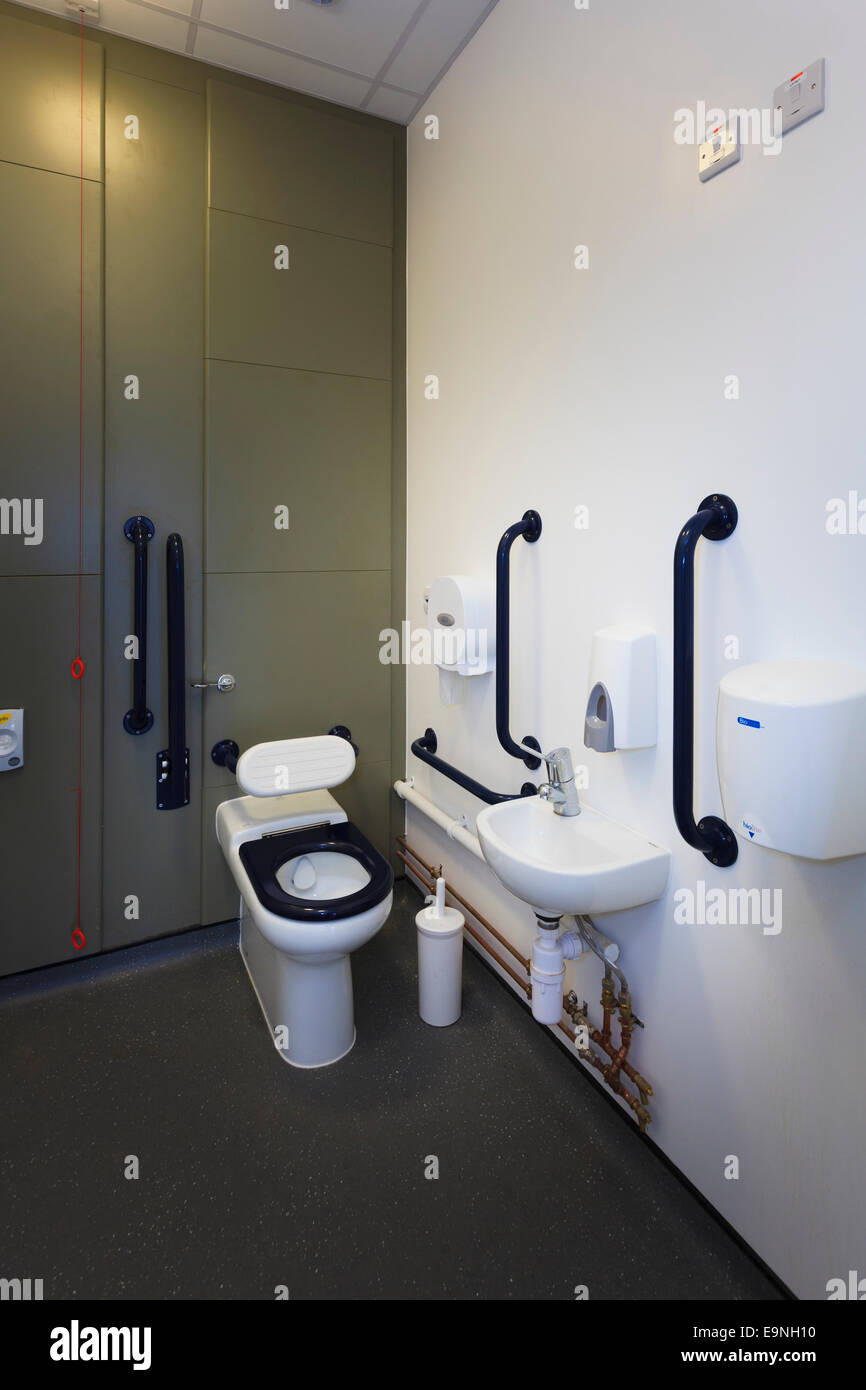 Disabled toilet cubicle with grab rails and wash hand basin at Isle ...