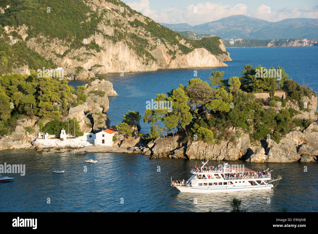 EPIRUS, GREECE. A tour boat passing Panagias Island in the bay of Parga. 2014. - Stock Image