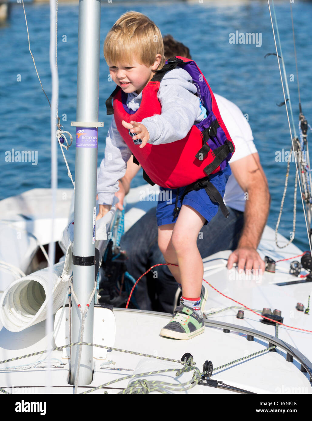 Freddie Simpson 4, and Iain Percy aboard their Star class keel-boat for the Bart's Bash sailing regatta in Weymouth, Stock Photo