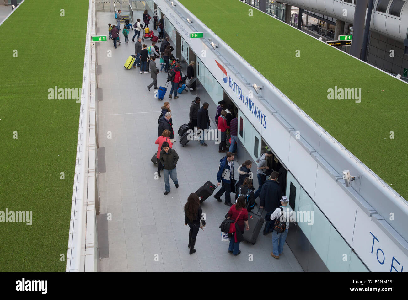 Monorail train platform at London Gatwick Airport North Terminal. Transport to South Terminal. People waiting on Stock Photo