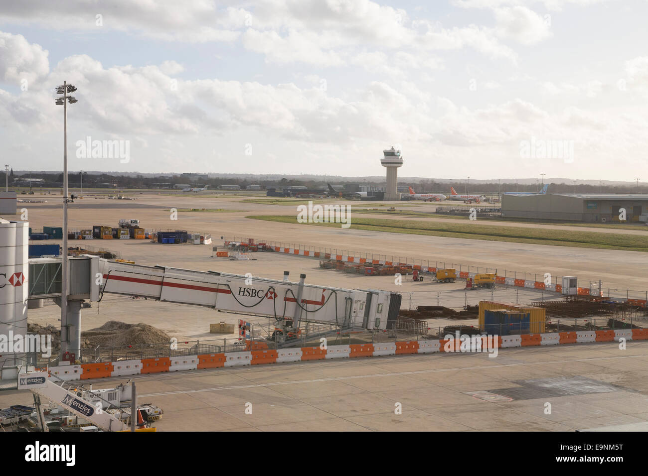 London Gatwick Airport, view from the terminal building. Repairs.Tarmac. - Stock Image
