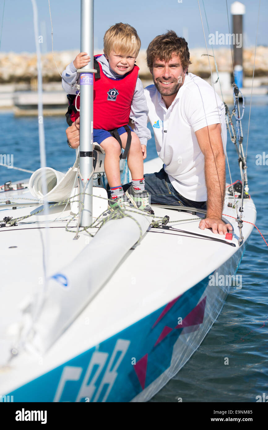 Freddie Simpson 4, and Iain Percy aboard their Star class keel-boat for the Bart's Bash sailing regatta in Weymouth, - Stock Image