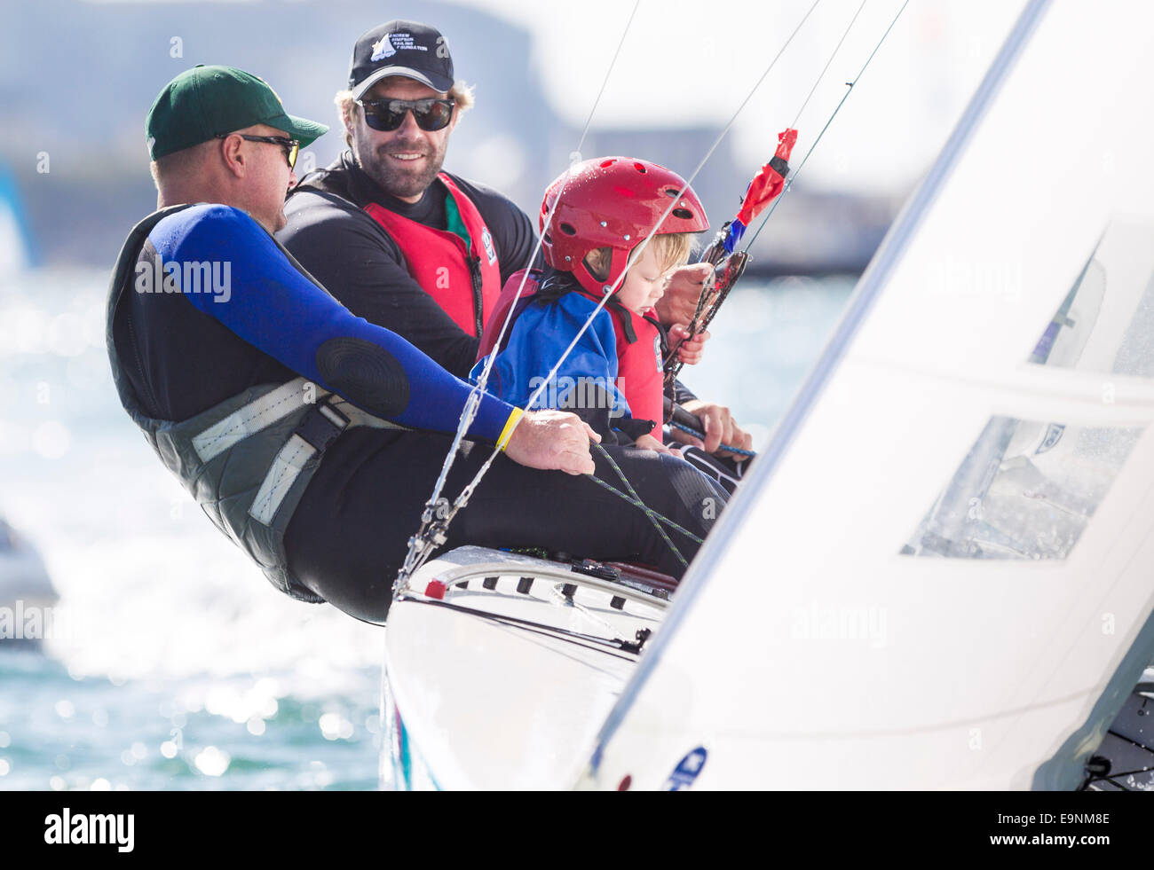 Freddie Simpson 4, and Iain Percy aboard their Star class keel-boat along with Australian sailor Anthony Nossiter - Stock Image