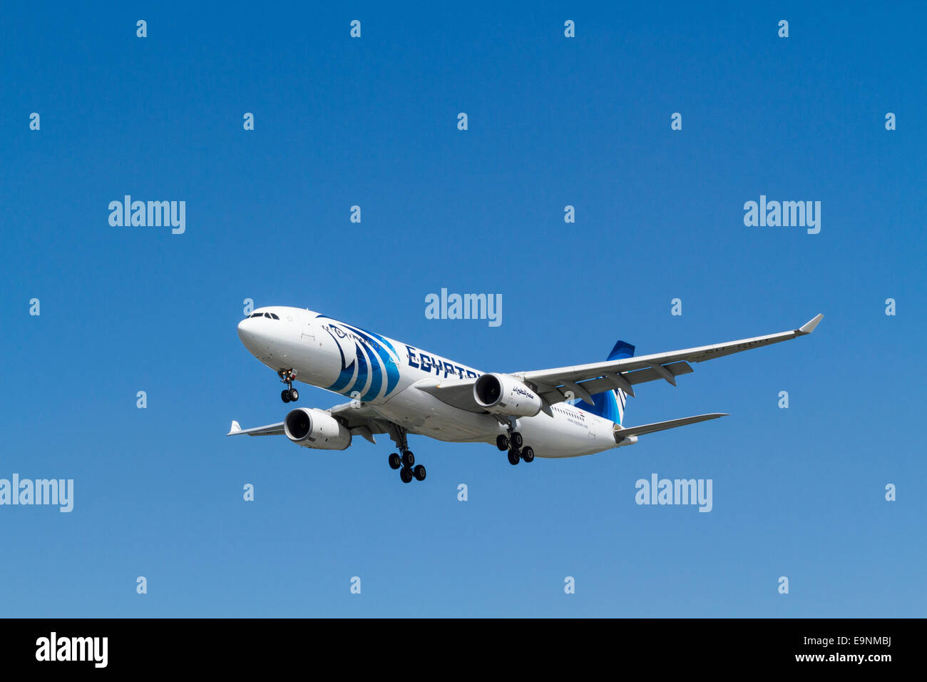 EgyptAir Airbus A320-200 on its approach for landing at London Heathrow, England, UK - Stock Image