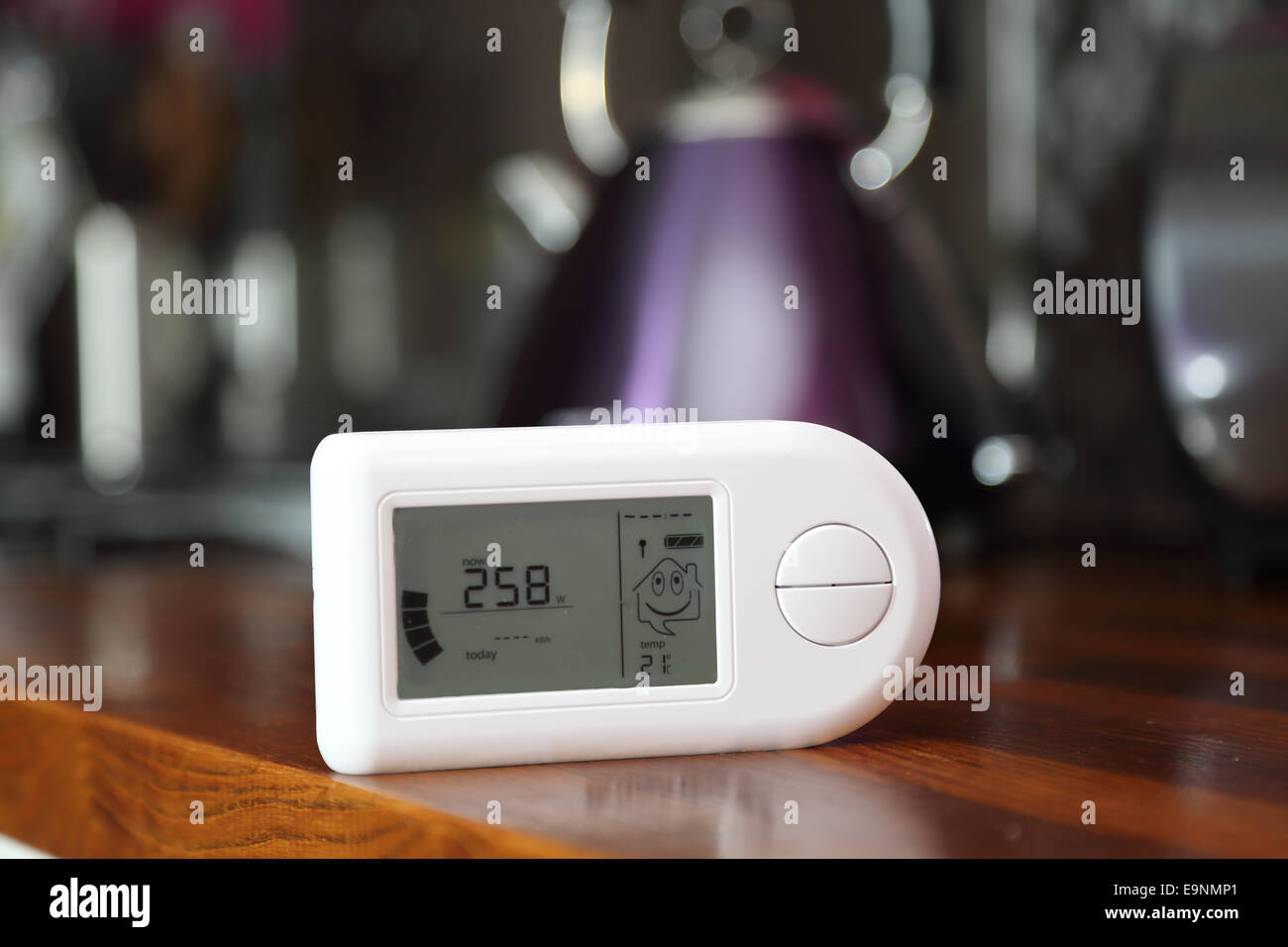 Close-up of a domestic electricity monitor in a kitchen showing a low level of energy consumption 2.58Kw Stock Photo