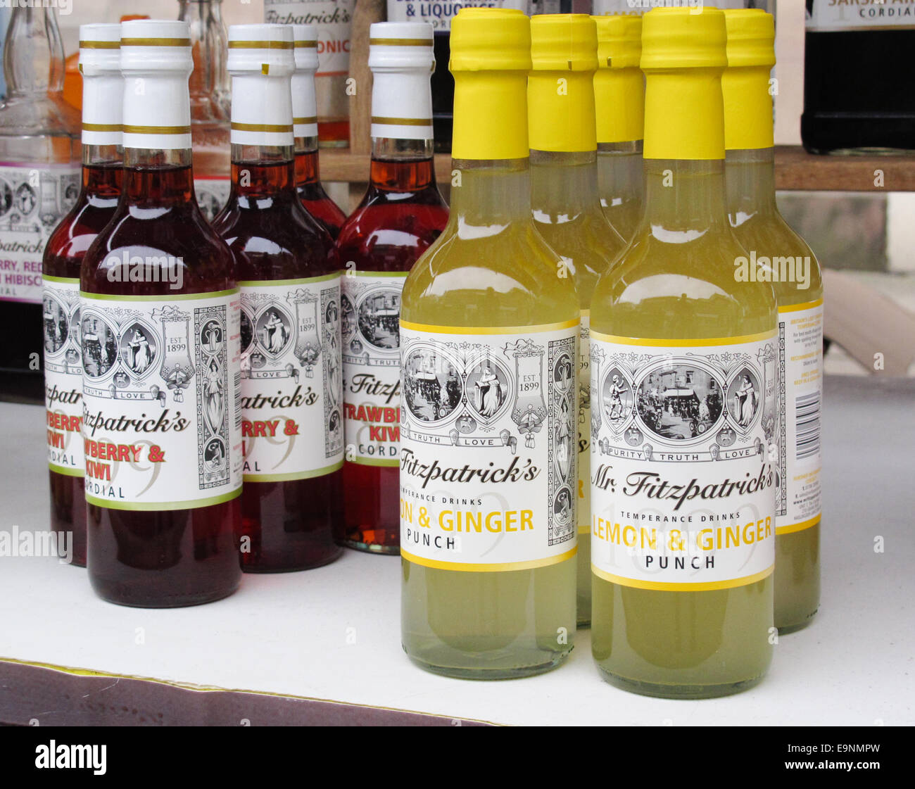 Bottles of lemon and ginger punch and cordial for sale. - Stock Image