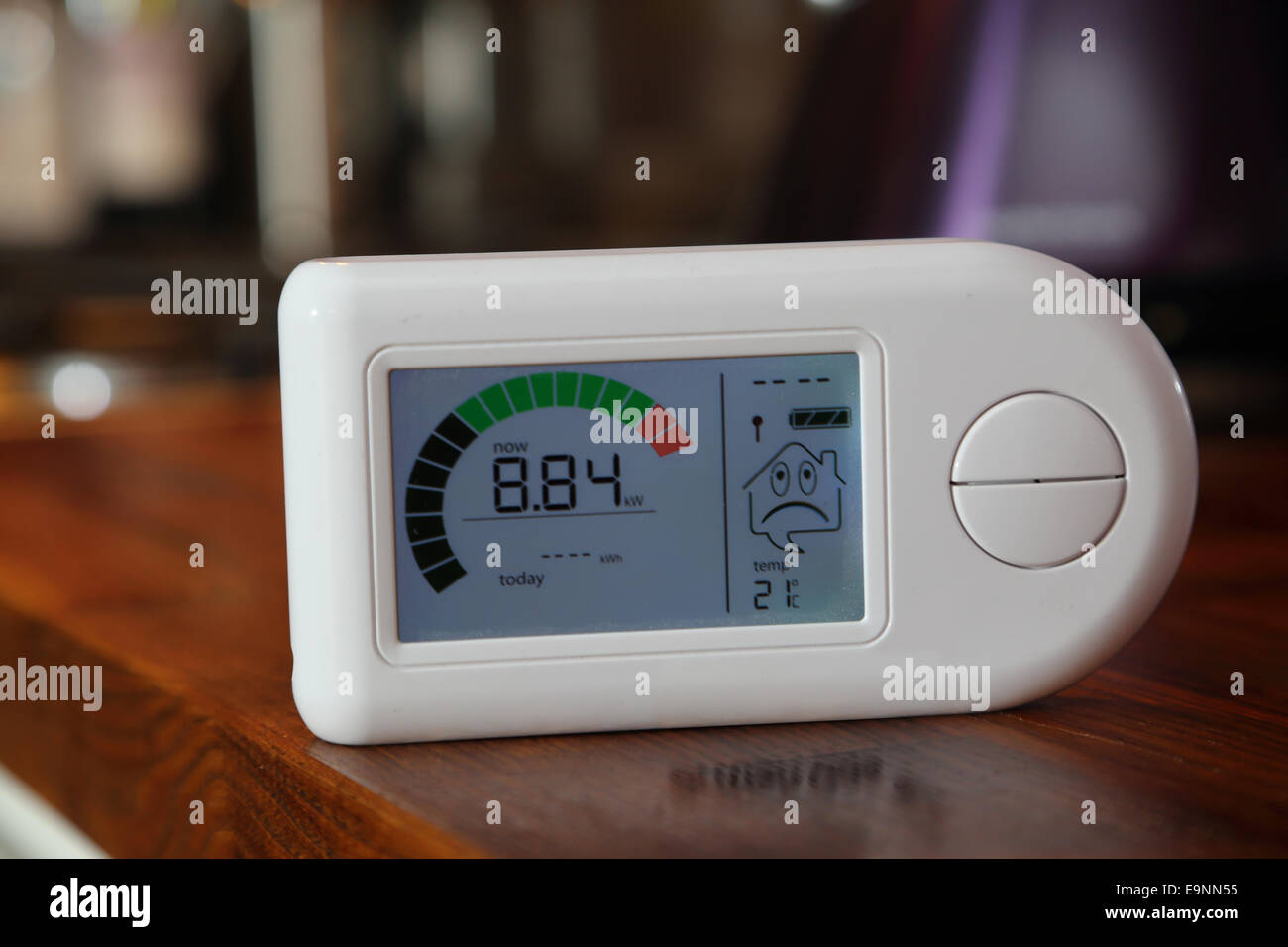 Close-up of a domestic electricity monitor showing a high level of energy consumption - 8.84Kw - Stock Image