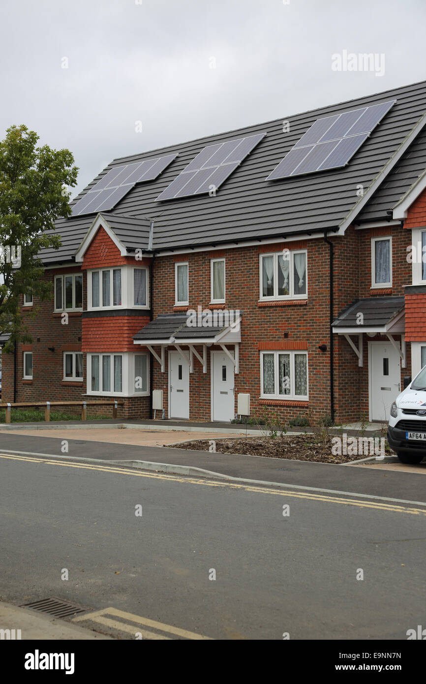 A new housing estate featuring solar PV panels installed on the pitched roof Stock Photo