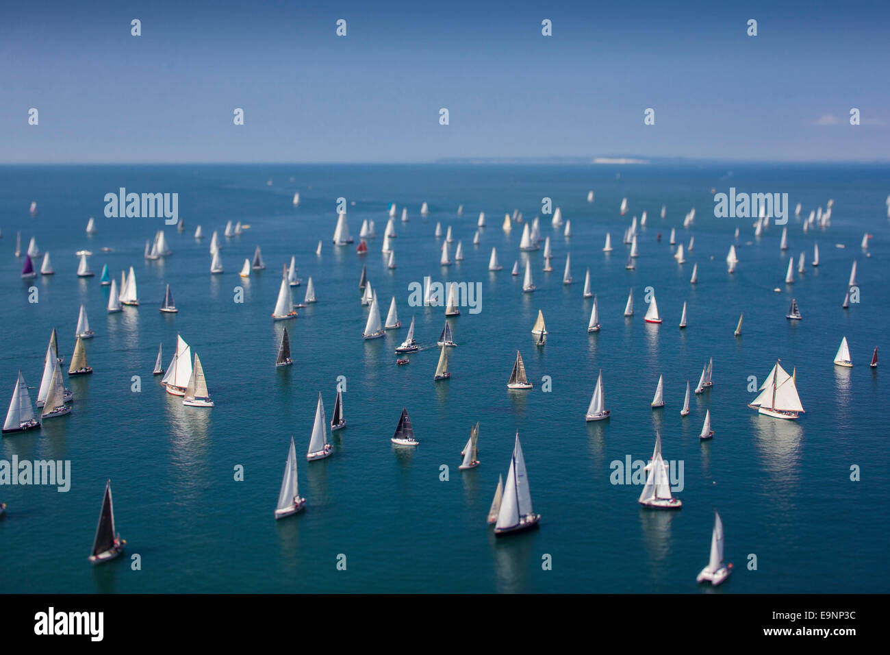 Yachts pass the Needles heading for St Catherine's Point during the 2014 JP Morgan Asset Management Round the Island Stock Photo