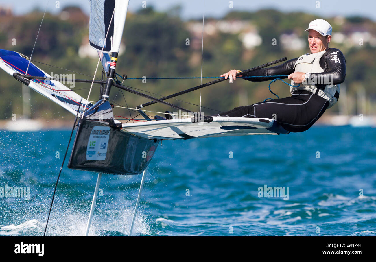Paul Goodison, former Laser Olympic and World champion, sailing his Foiling Moth in Portland Harbour. Stock Photo