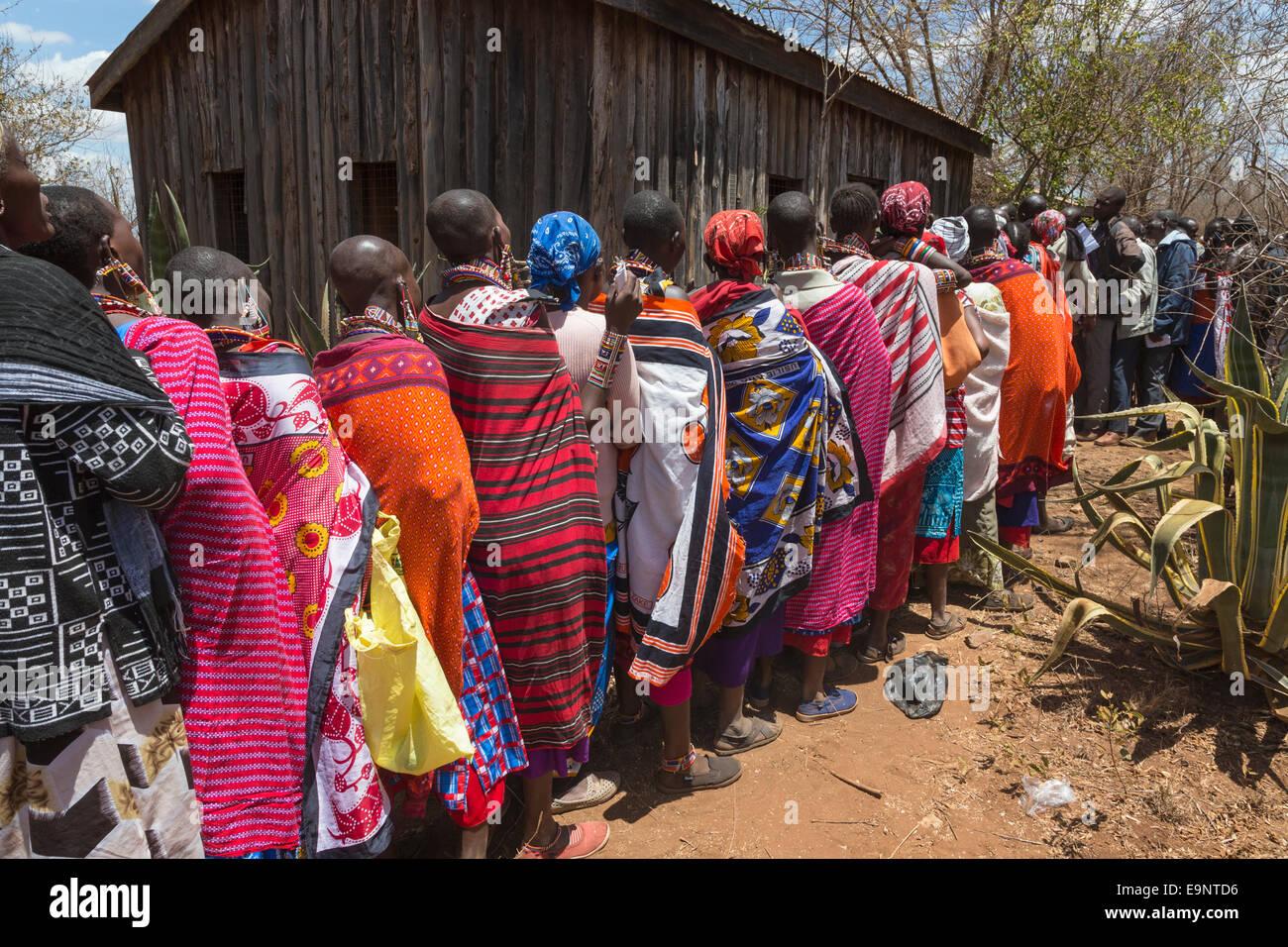Maasai women at the Predator Compensation Fund Pay Day, Mbirikani Group Ranch, Amboseli-Tsavo eco-system, Kenya, - Stock Image