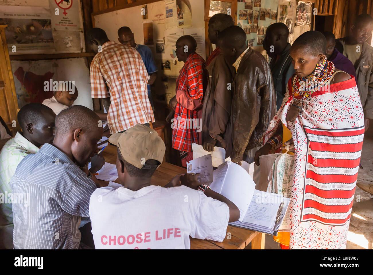 Maasai claiming payment at the Predator Compensation Fund Pay Day, Mbirikani Group Ranch, Amboseli-Tsavo eco-system, - Stock Image