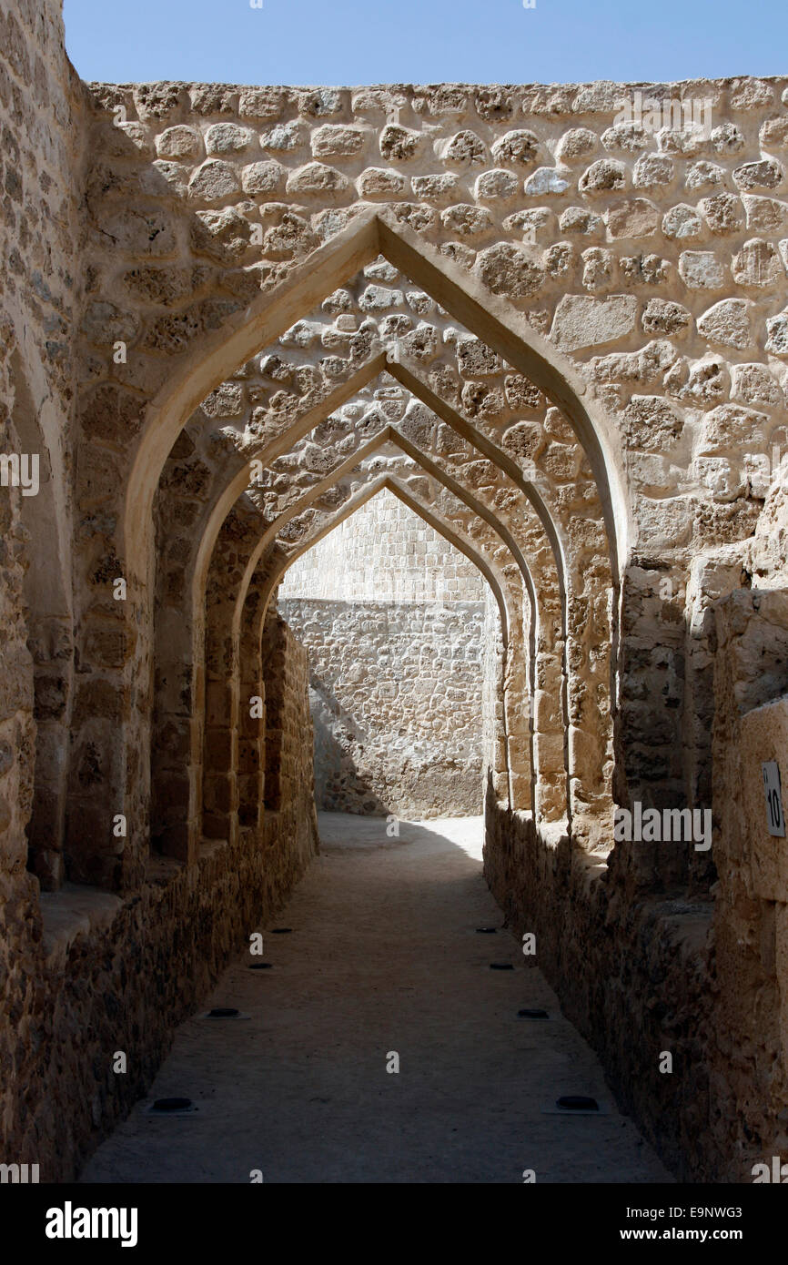 Arches at the Qala'at Bahrain, also known as the Portuguese Fort, near Manama, Bahrain - Stock Image