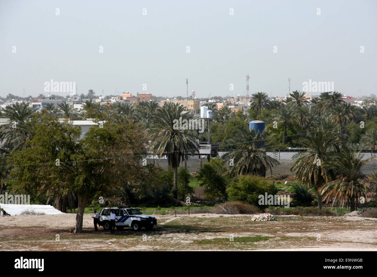 Police in the grounds of Qala'at Bahrain, also known as the Portuguese Fort, near Manama, Bahrain - Stock Image