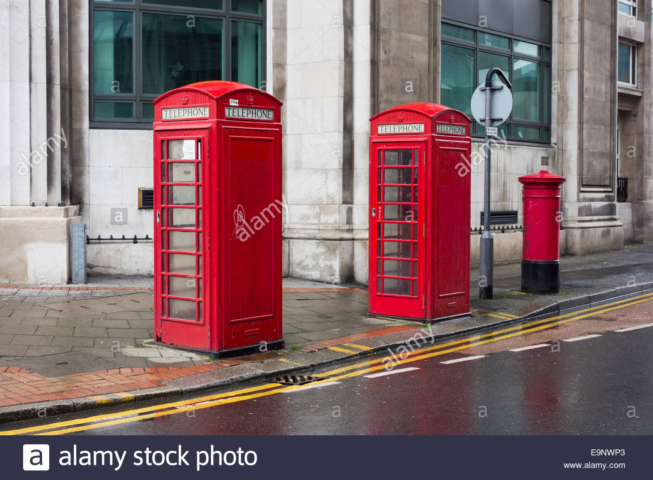 Two red phone boxes and a red postbox in Sheffield, England - Stock Image
