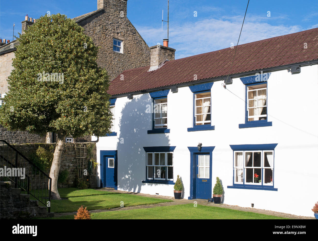 Traditional white painted cottage, Middleton in Teesdale, north east England, UK - Stock Image