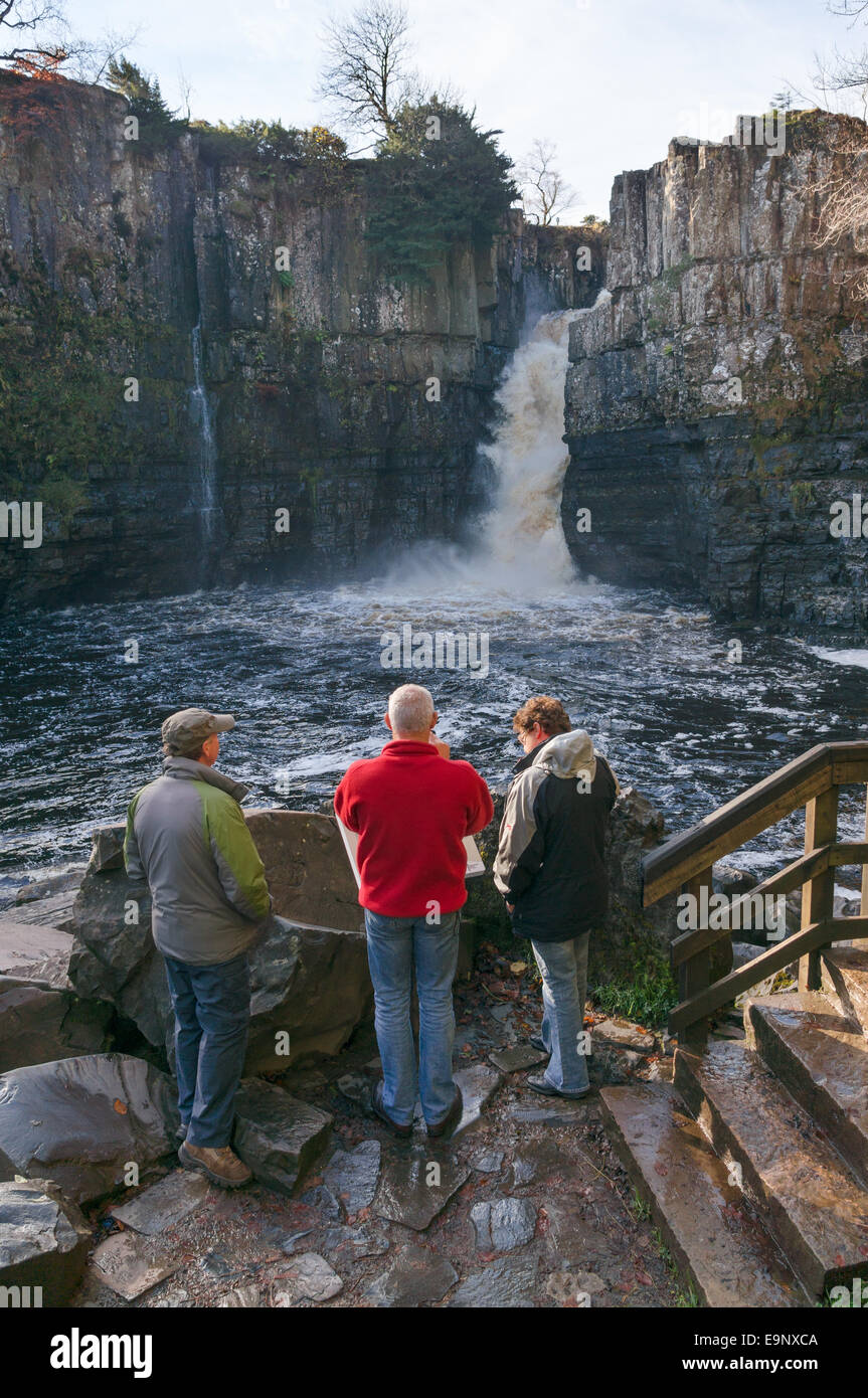 People looking at High Force waterfall in Teesdale, north east England, UK - Stock Image