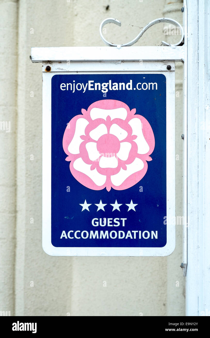 4 star guest house accommodation sign Stock Photo