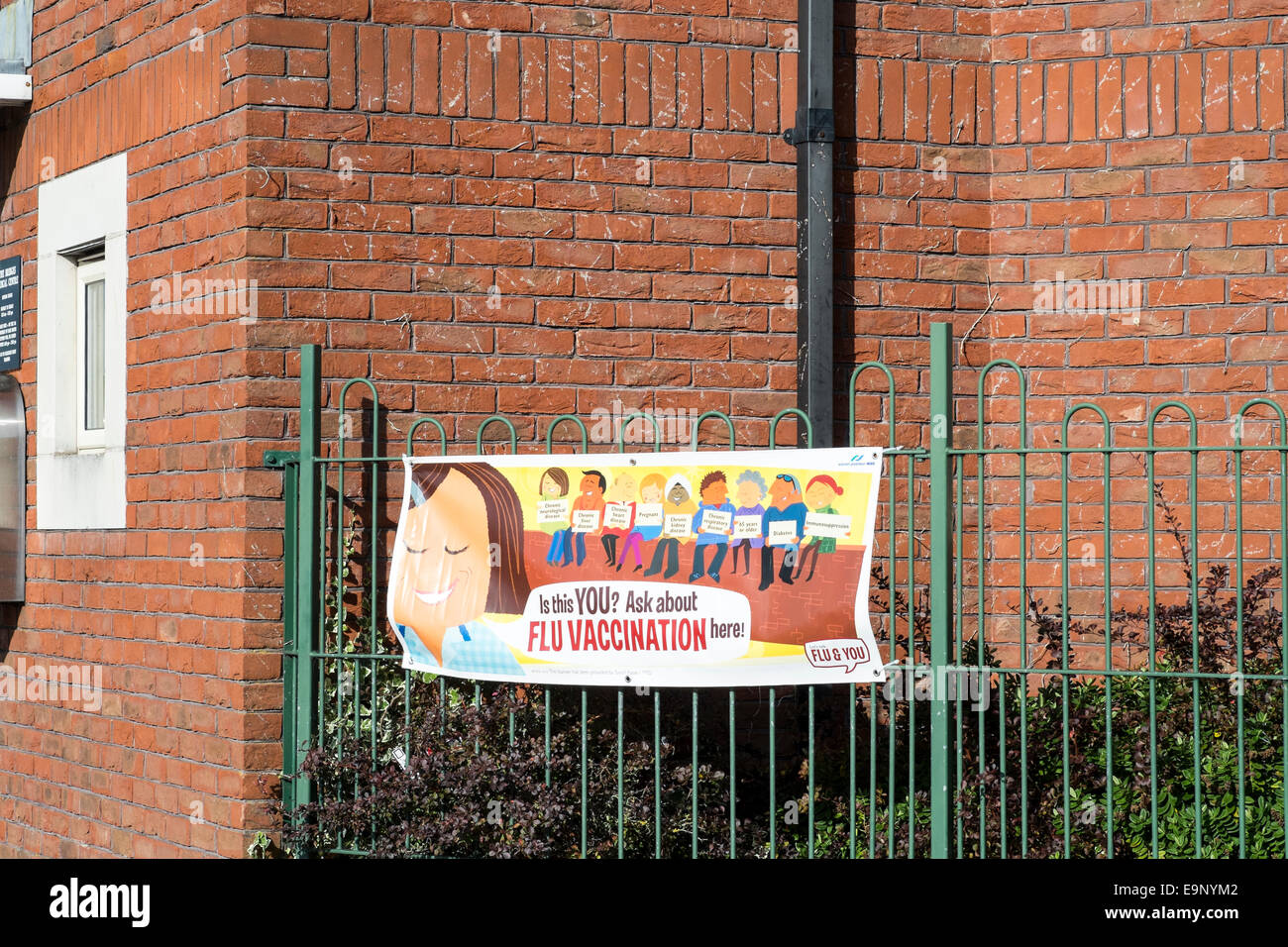 Banner on fence advertising flu vaccination - Stock Image