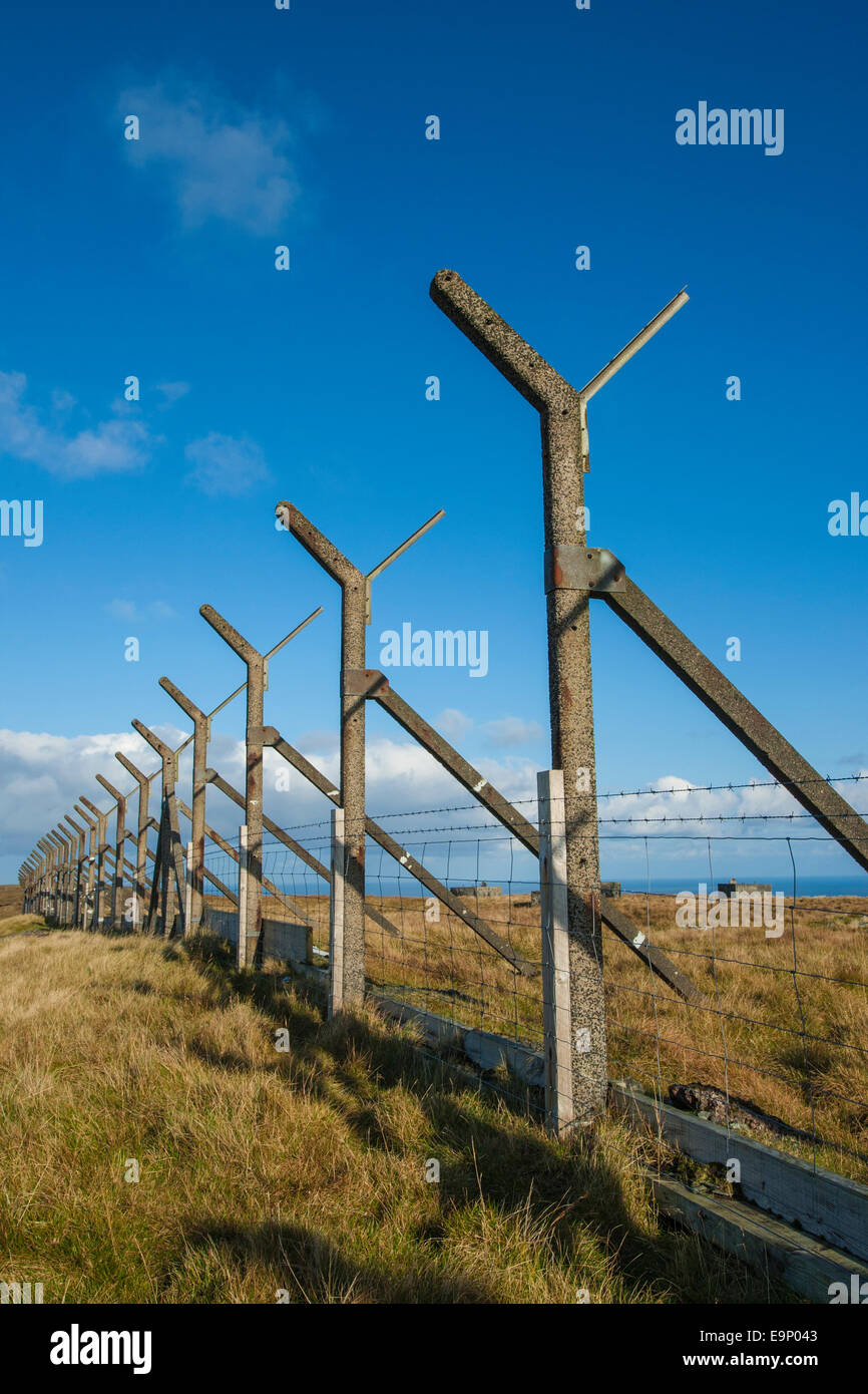 Line of old concrete fence posts that were part of a security fence around an old radio station, Ward of Scousburgh, - Stock Image
