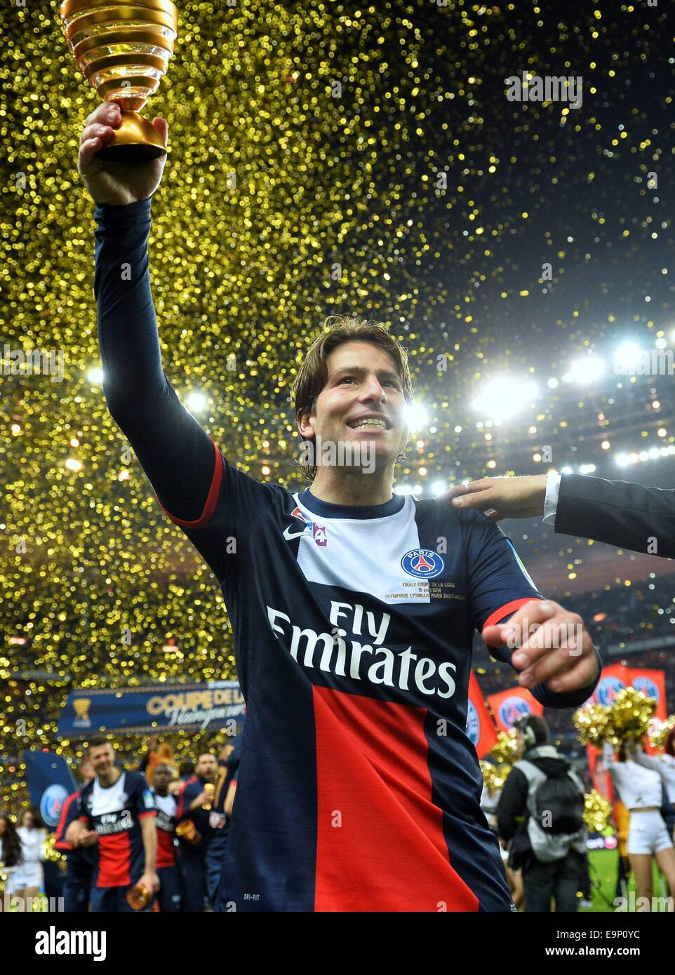 St. Denis, France. 30th October, 2014. Stade de France, St Denis, PSG versus Lyon. Maxwell (psg) with the trophy Stock Photo