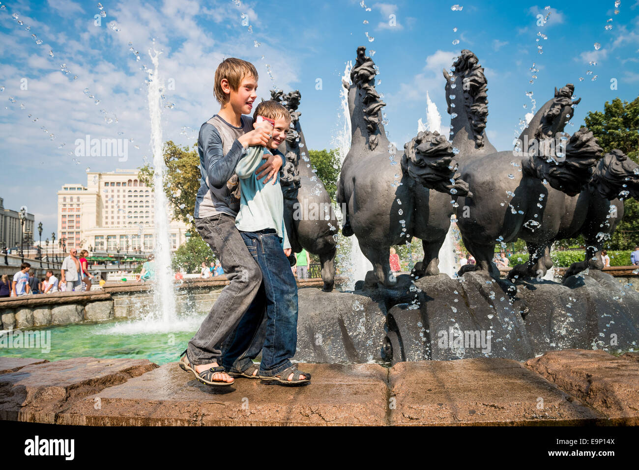 Alexander Garden in Moscow attract people in hot Russian summer - Stock Image