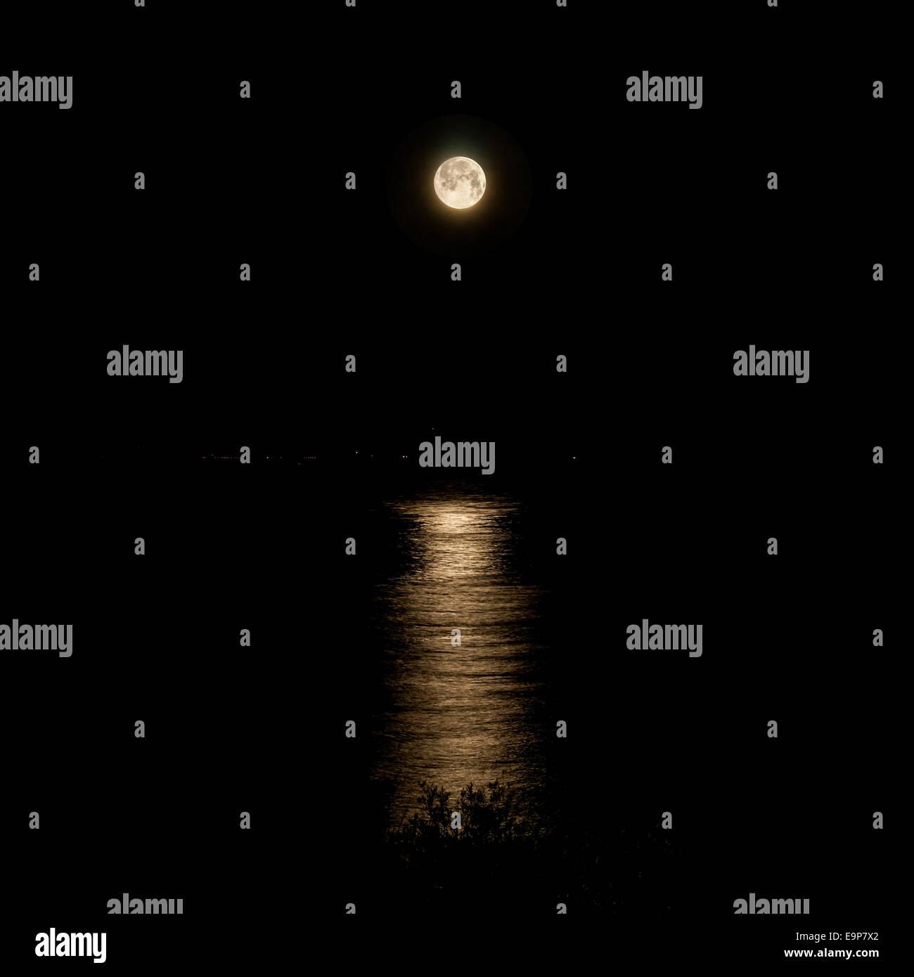 Full Moon and moonlight on night sea - Stock Image