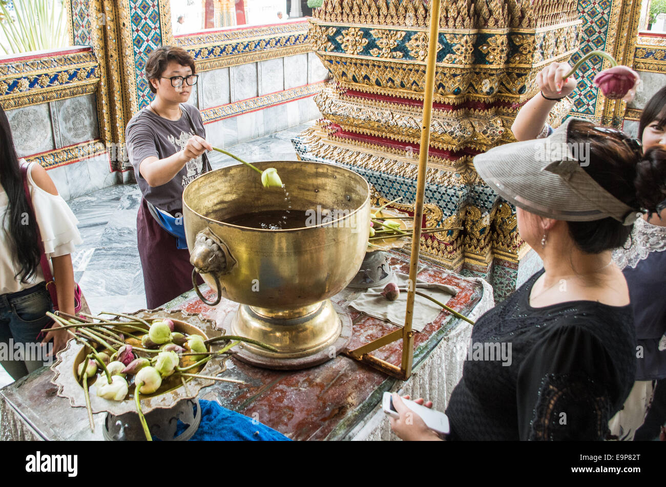 People is doing rituals in Wat Phra Kaew of bangkok grand palace - Stock Image