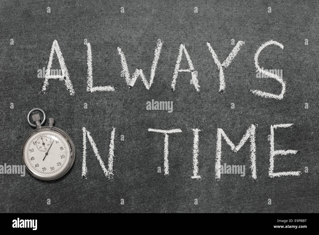 always on time concept handwritten on chalkboard with vintage precise stopwatch used instead of O - Stock Image