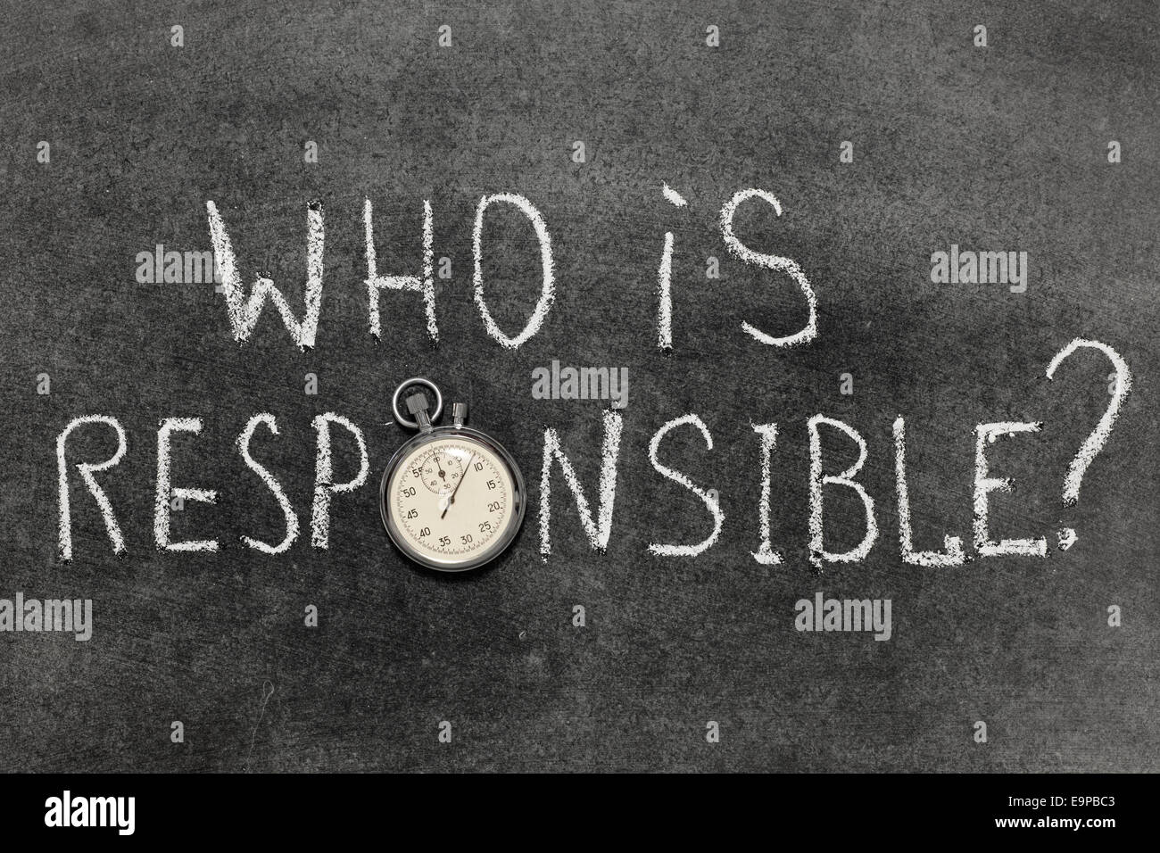 who is responsible question handwritten on chalkboard with vintage precise stopwatch used instead of O - Stock Image