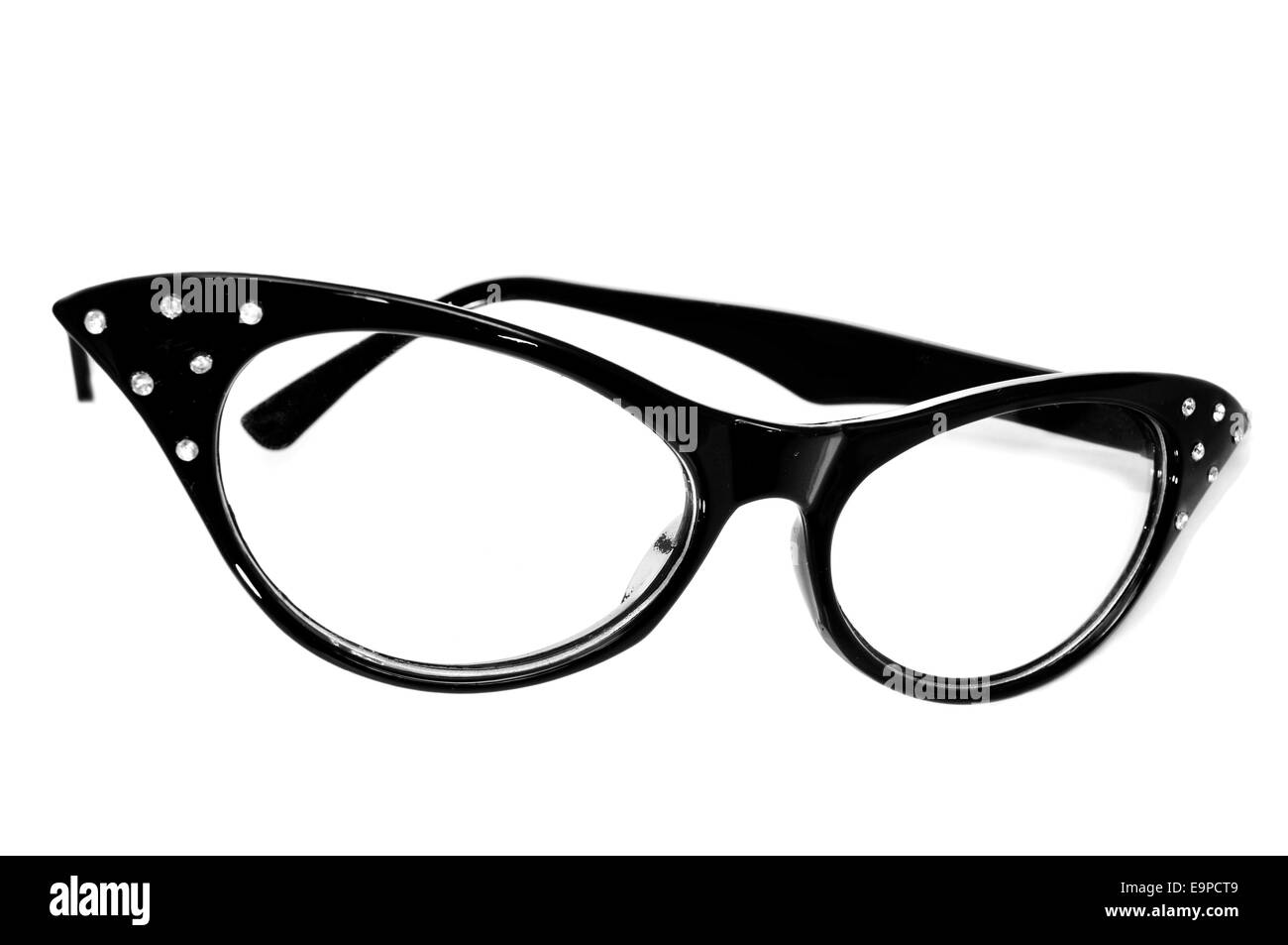 closeup of a black retro-styled eyeglasses for women on a white background - Stock Image