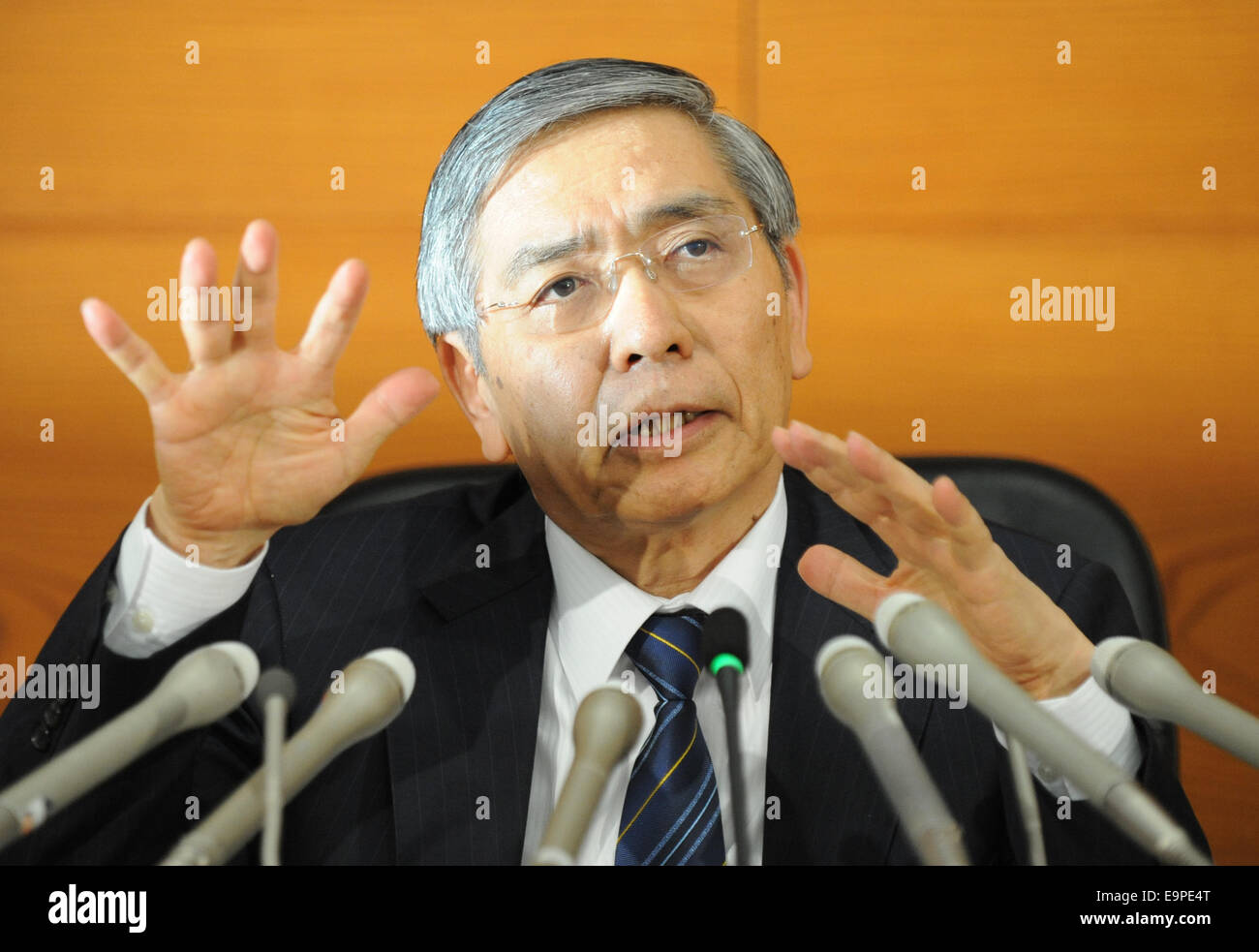 Tokyo, Japan. 31st Oct, 2014. Haruhiko Kuroda, governor of the Bank of Japan (BOJ), attends a press conference at - Stock Image