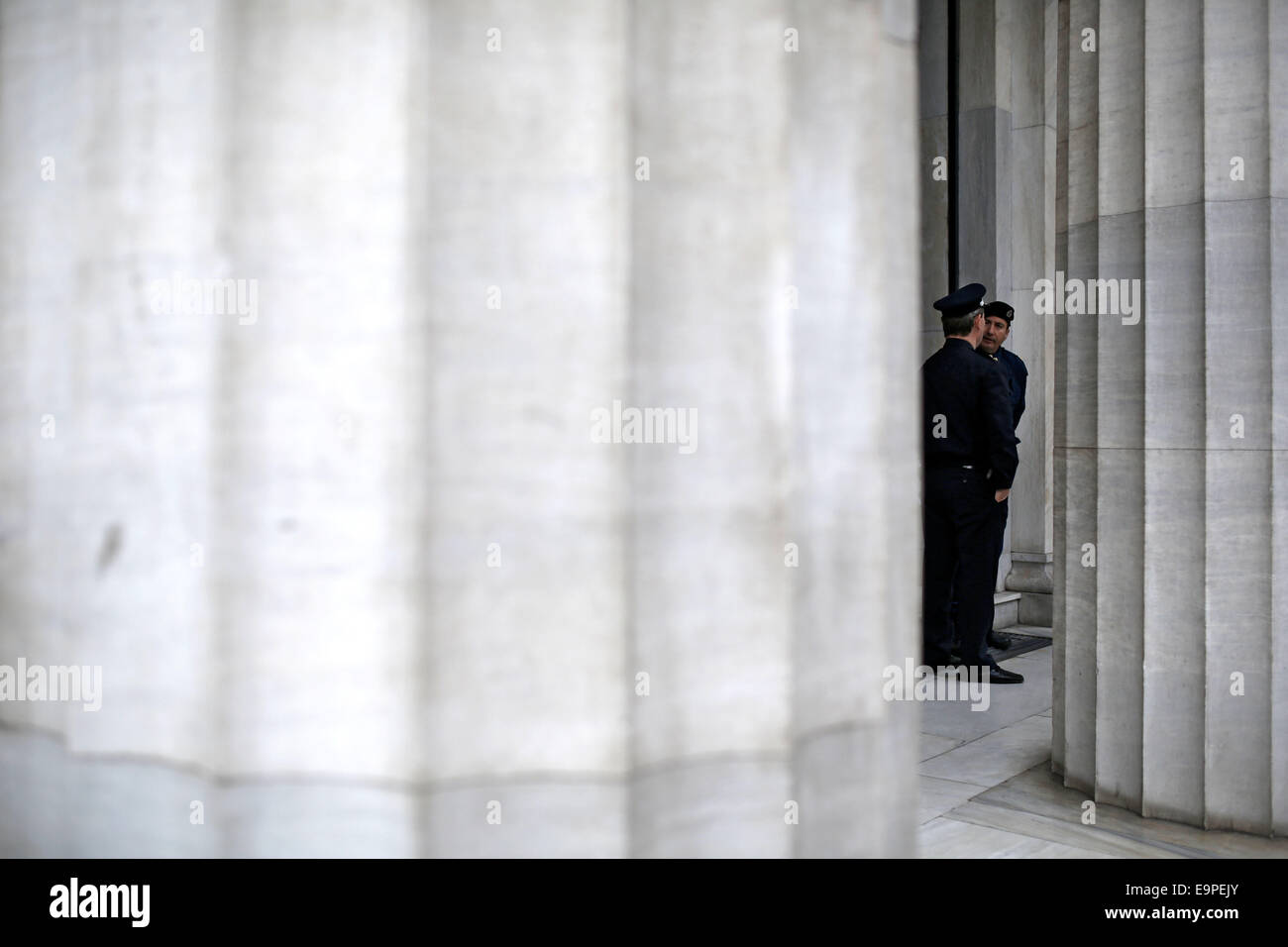 Thessaloniki, Greece. 31st Oct, 2014. Police officers guard the protest outside the Bank of Greece branch. On the - Stock Image