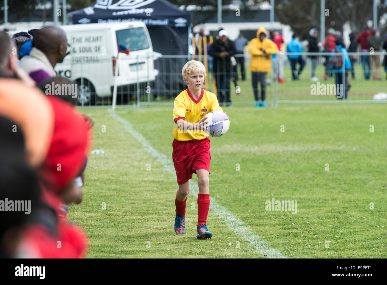 Junior football player making a throw-in, Cape Town, South Africa - Stock Image