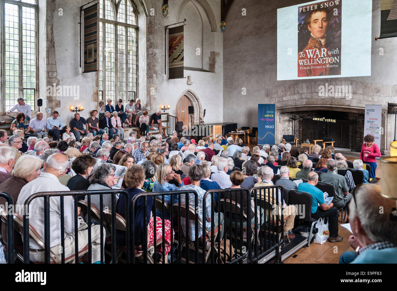 Dartington Hall, Totnes, Devon, UK. Festival goers in the packed Great Hall at the Ways With Words literary festival - Stock Image