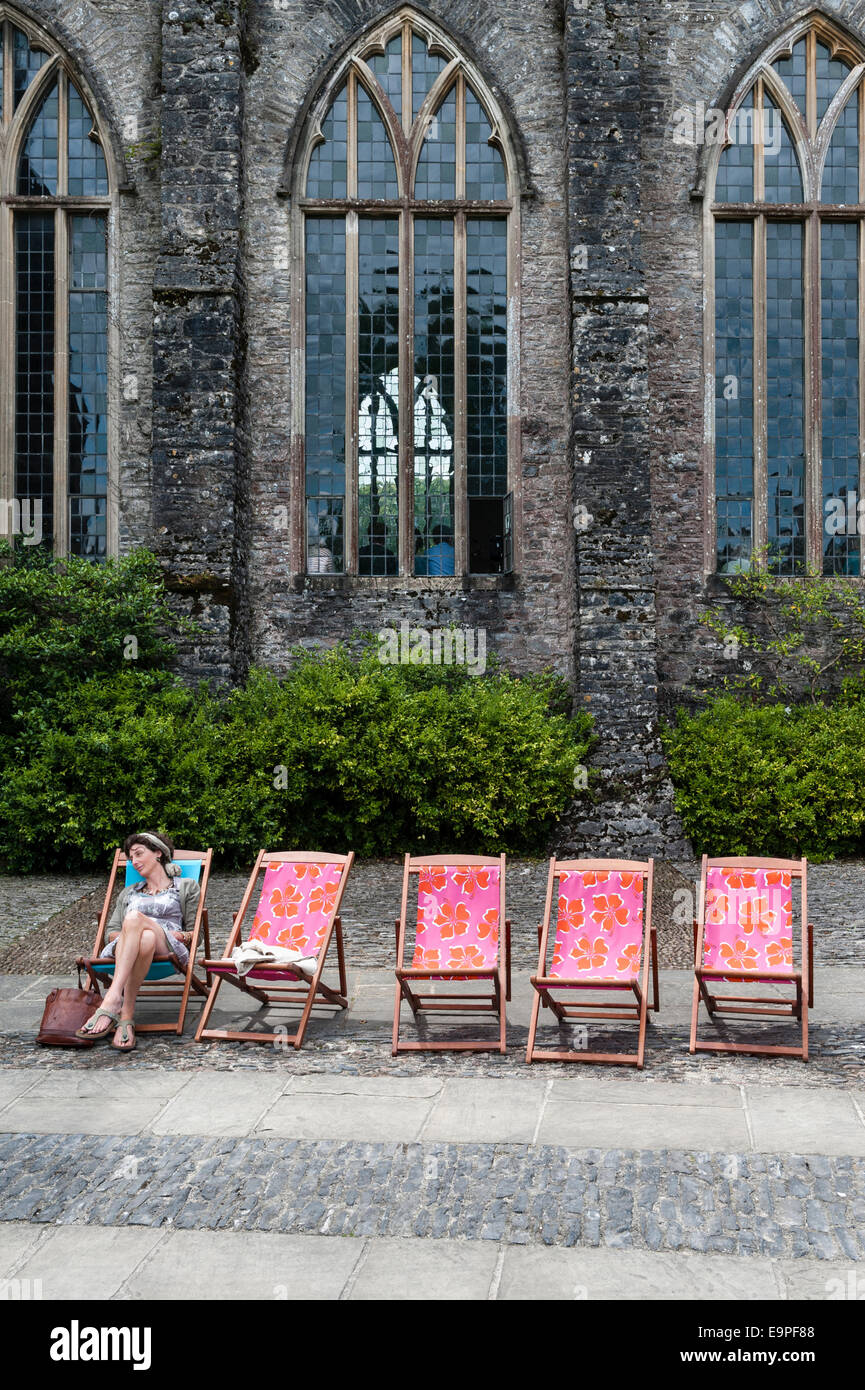 Dartington Hall, Totnes, Devon, UK. A festival goer taking a break at the Ways With Words literary festival - Stock Image