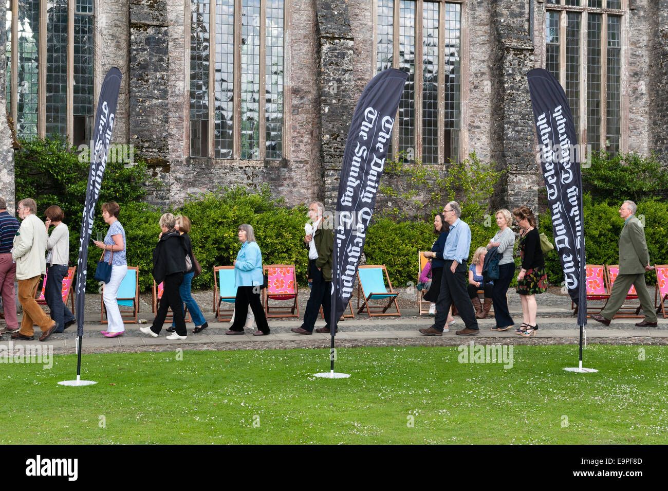 Dartington Hall, Totnes, Devon, UK. Festival goers queue for entry at the Ways With Words literary festival - Stock Image