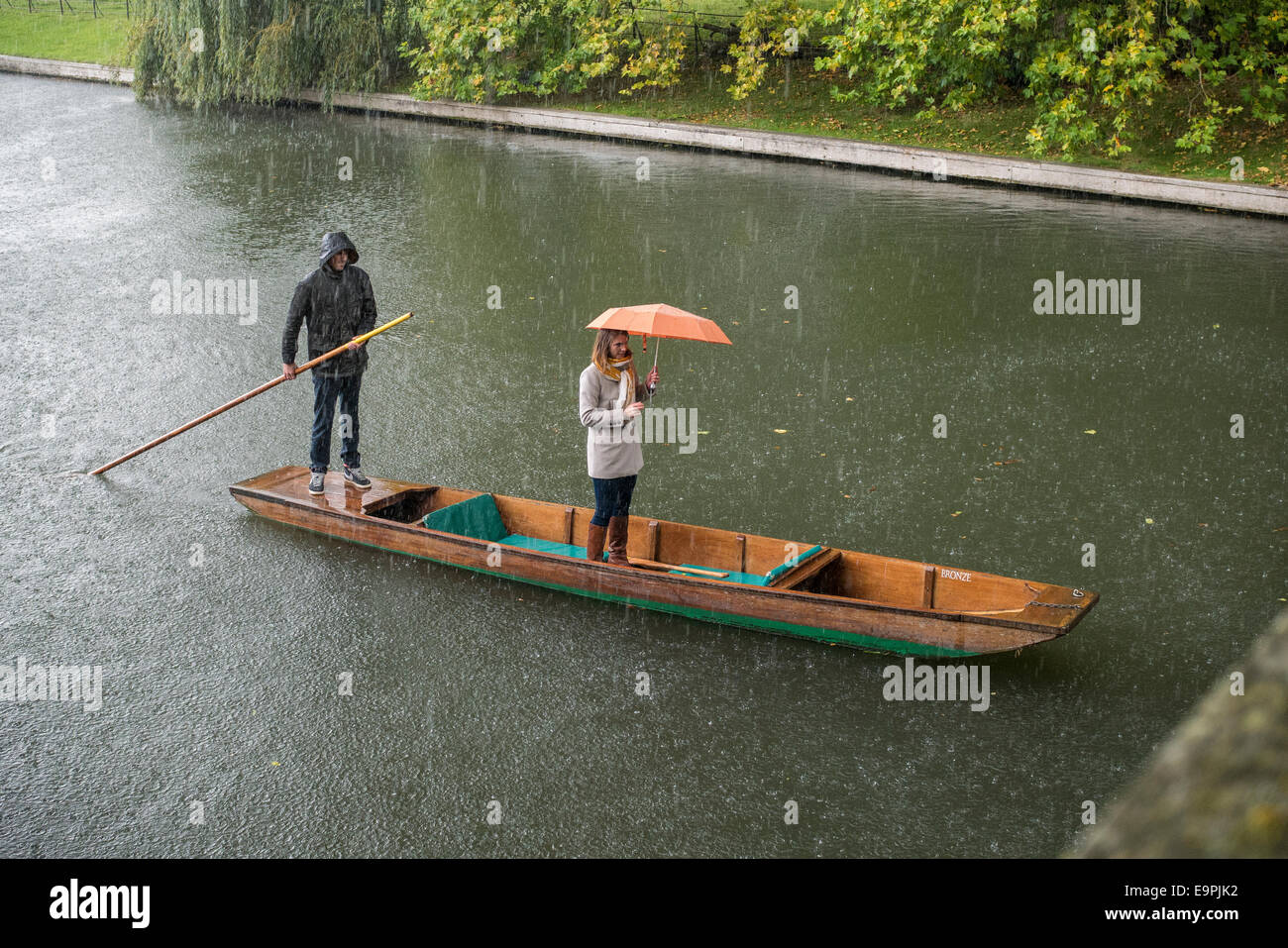Rain shower whilst punting on the River Cam, Cambridge UK - Stock Image