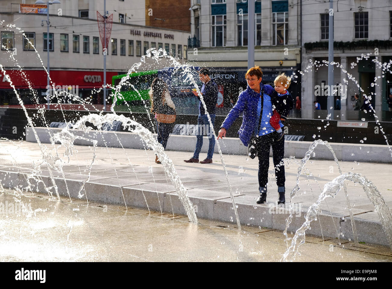Nottingham, UK. 31st October, 2014. UK weather. Set to be the warmest Halloween on record. People play in the fountains - Stock Image