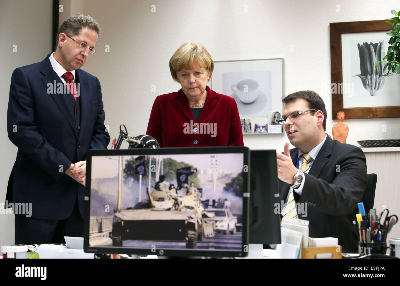Cologne, Germany. 31st Oct, 2014. German Chancellor Angela Merkel (L) speaks to the president of the Federal Office - Stock Image