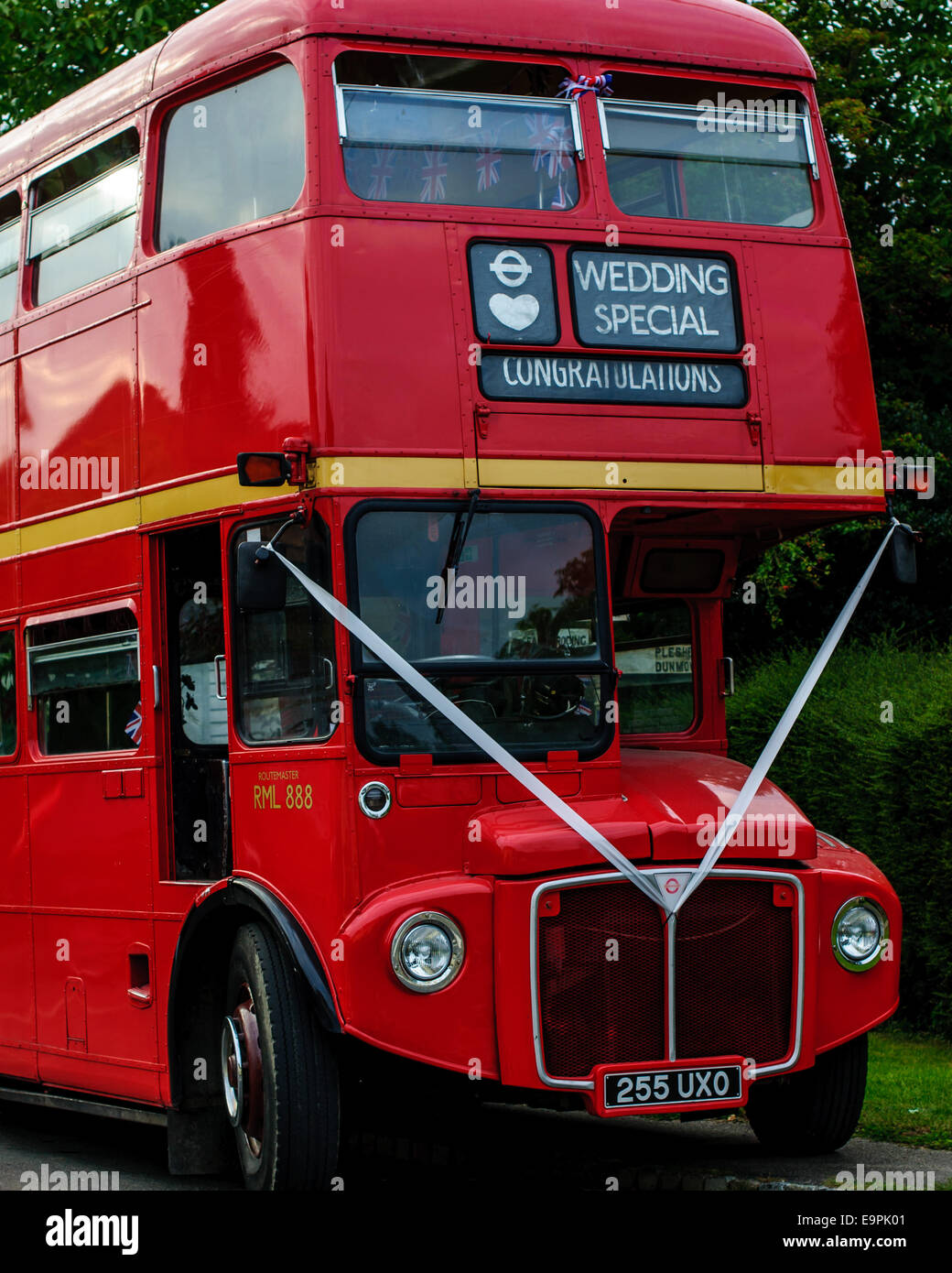 Old red double decker bus decorated for wedding. - Stock Image