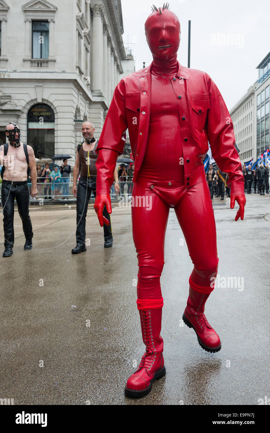 Reveller completely covered in a red latex suit, during the Pride in London parade 2014, London, England - Stock Image