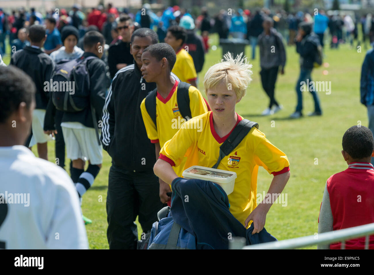 Junior football player walking off the field after a match, Cape Town, South Africa - Stock Image