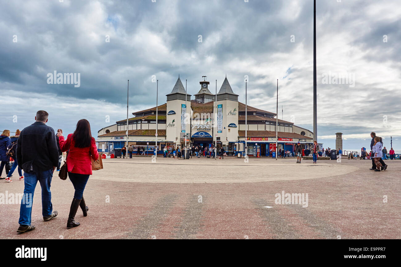 Bournemouth Pier Family Amusements on an overcast day, with many visitors nearby. Dorset, England, UK. - Stock Image