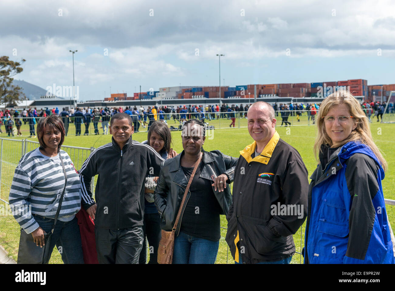 Parents of junior football players posing for a photo, Cape Town, South Africa - Stock Image