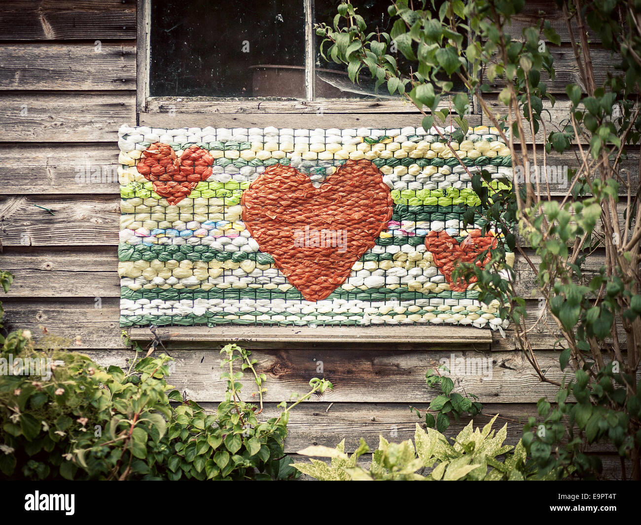 vintage hearts on the side of a shed - Stock Image