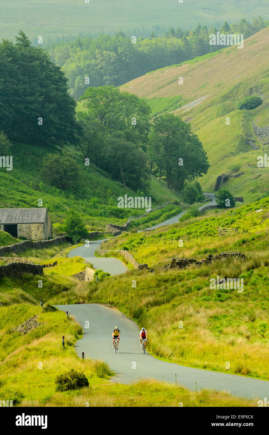 Cyclists starting the climb of the Trough of Bowland Lancashire - Stock Image