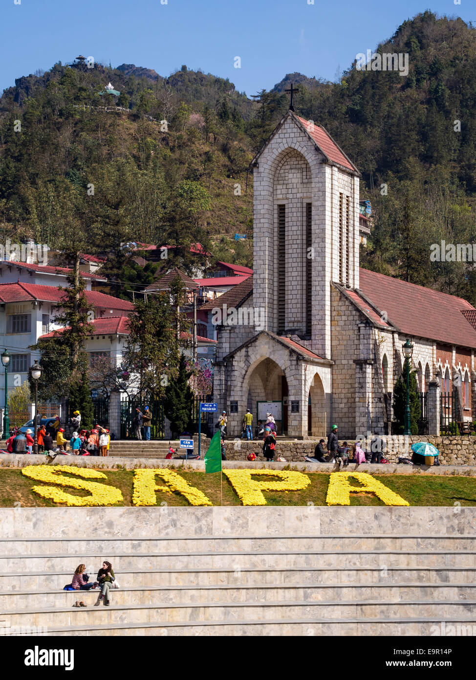 The Holy Rosary church and people around the main square of Sapa town, Lao Cai Province, Vietnam. Stock Photo