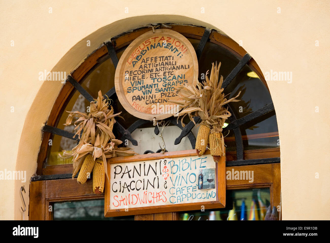 Siena, Tuscany, Italy. Signs outside a corner shop in Via Tito Sarrocchi selling traditional food and drink products. Stock Photo